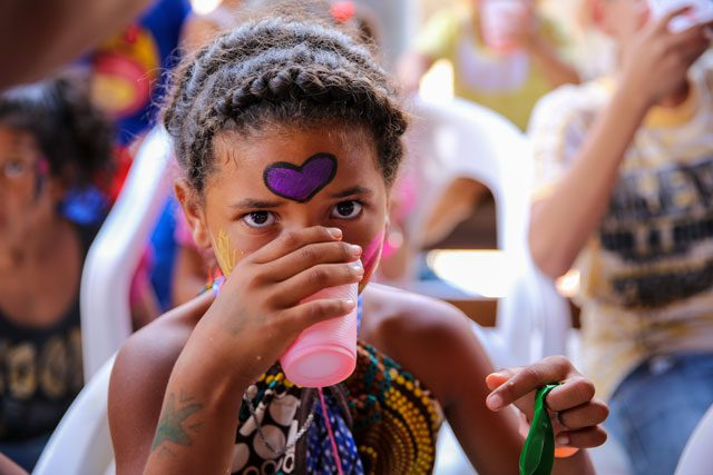 young girl drinking from cup
