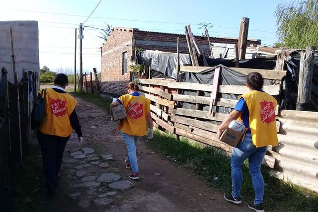 Salvation Army workers Walking in Village in Uruguay
