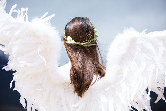 Woman wearing angel wings