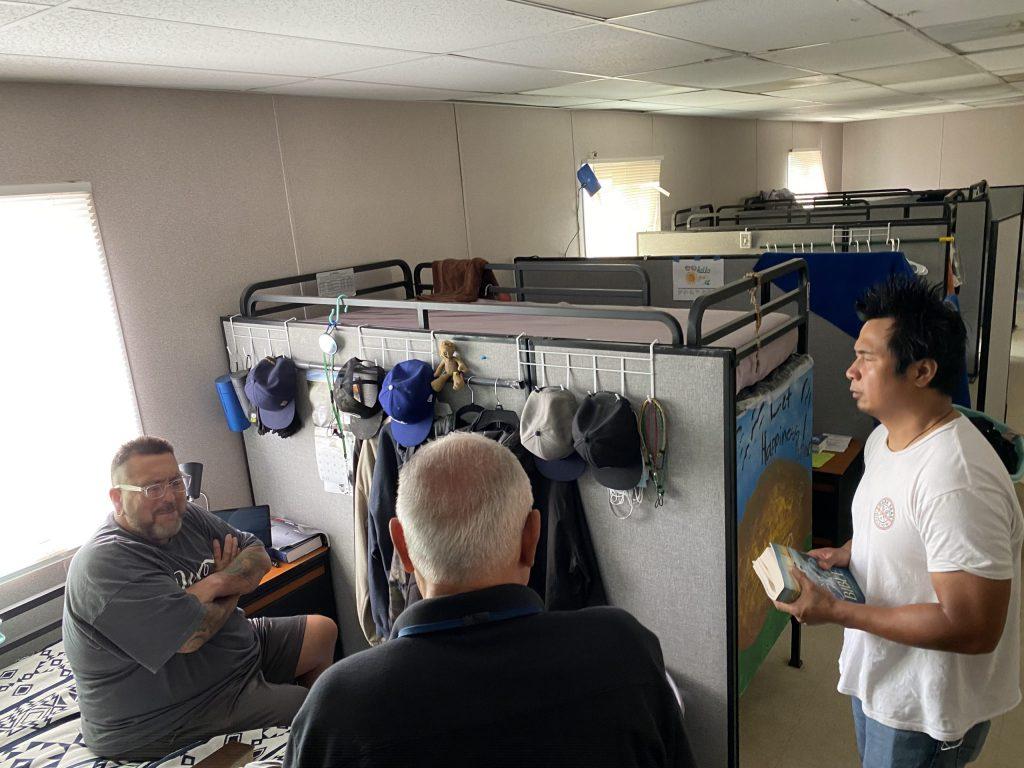 Men talking inside