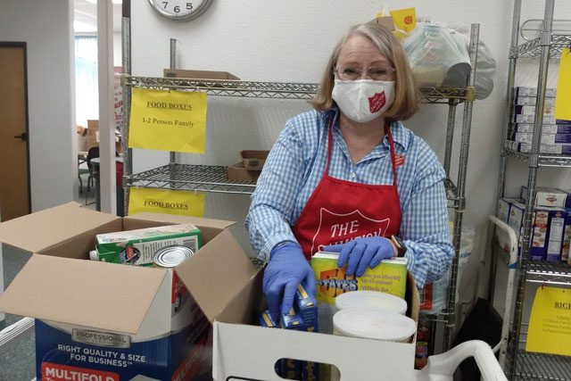 Woman in food pantry